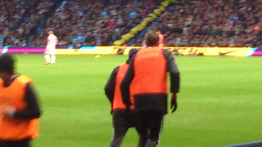 Peter Crouch warming up (he's the lanky one)