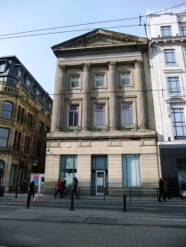 A quirk of architecture typical of the buildings and streets in Manchester. This brown sandstone building is nestled in the midst of granite and limestone
