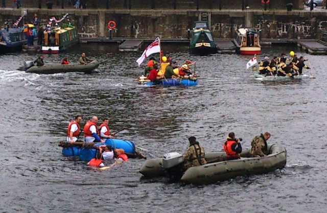 Emma's raft is the one in the middle at the top of the picture. She is in the straw hat at the front on the right.