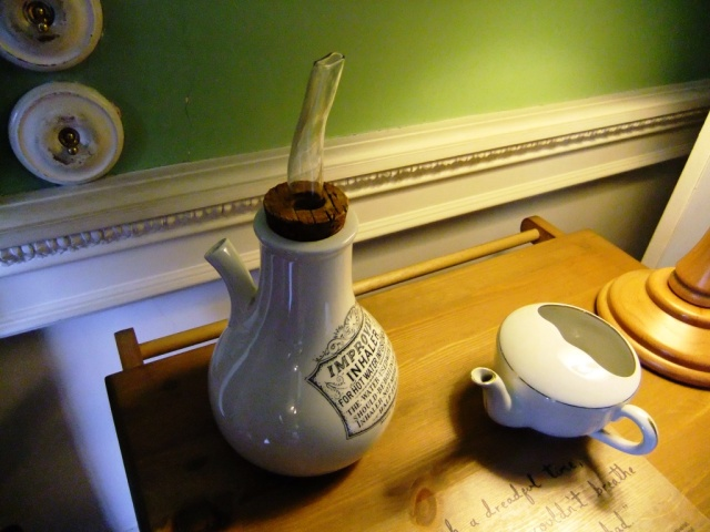 Fascinating insight into the tools of the nursing trade here. The feeding cup on the right shows how invalids would have drank their tea or soup, and the inhaling bottle on the left is an ingenious contraption to help patients with breathing difficulties breathe easier.