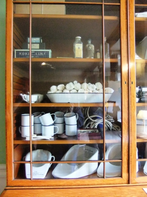 A typical supply cupboard on the ward. There were two of these in the museum with medical supplies in - you can see bandages, cups, linament and bottles for the male patients to urinate into. The other one had blankets and linen in it.