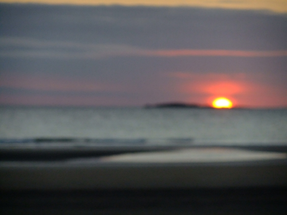 The sun rising over the Farne Islands