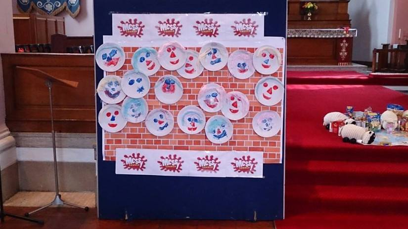"Our ""belonging"" wall from Messy Church yesterday. You can also see in the background the beginnings of our Harvest collection of food to share with the homeless in Manchester."
