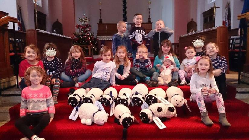 This is a group shot of the children at Messy Christmas yesterday. We have been running a lost sheep trail in Blackley during Advent and as you can see we have got a safely gathered flock in church now. And we managed to round up the sheep too!