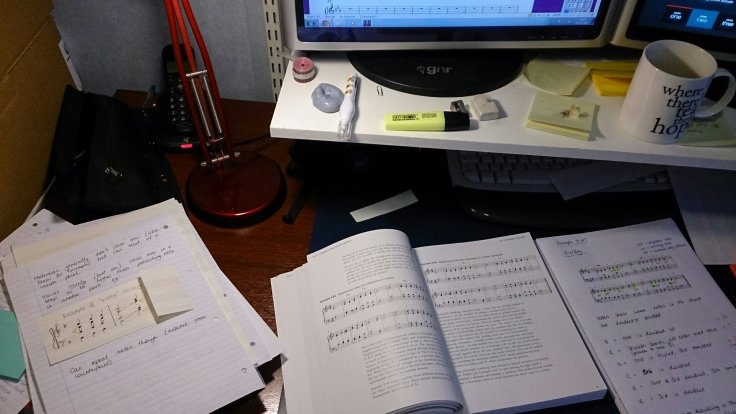 Double screen (one for the darts, one for the music score!) books, notes, manuscript paper...catching up missed work nicely!