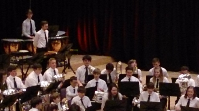 The GMHYBB, close up of my son on Bass Trombone (he's the one with the mass of curly black hair in the centre of the photo)