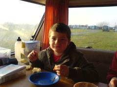 In the caravan enjoying bacon and beans