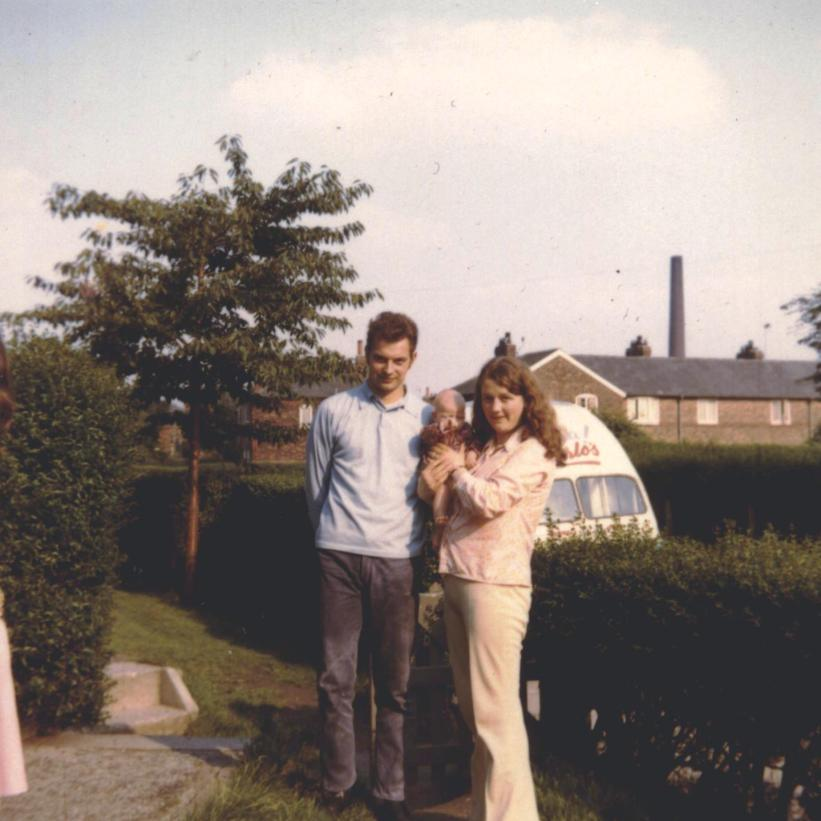 And here you have 1971 in glorious technicolour. My Gran's front garden with my mum and dad who look like children themselves. My Gran still lives this house.