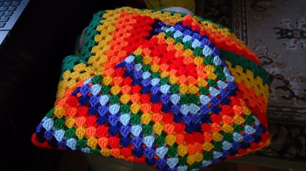 """Rectangle blanket based on the traditional """"granny"""" stitch, using rainbow colours. Three repeats of the individual colours followed by three rows of each colour afterwards. Just starting the blue three now and hopefully will finish it this weekend."""